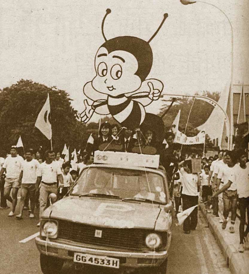 caption - Teamy, the productivity mascot, accompanied unionists on a peaceful march through Chinatown in 1982.